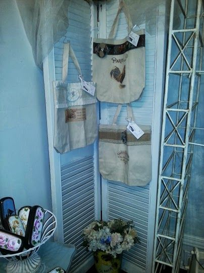 My booth space at Coach House studio.. Had to rearrange this wall as larger wicker shelf blocked the entrance.. added old shutter to add some texture to wall corner.. better display for my market bags.  #anniesloanchalkpaint #duckeggblue on wall