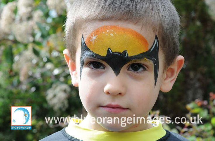 Blue Orange Images facepainting Watford, Boy face painted with a silhouette batman design with glitter