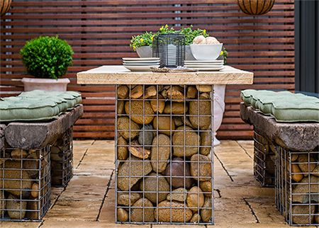 Home-Dzine - Gabion-style outdoor table set - Use gabion baskets - or make your own using steel mesh - fill with pebbles or stone and add reclaimed wood or railway sleeper tops and you have a modern outdoor dining set that is easy to make, won't cost a fortune and is practically maintenance free! - See more at: http://www.home-dzine.co.za/garden/garden-gabion-set.htm#sthash.qJPwTp5R.dpuf