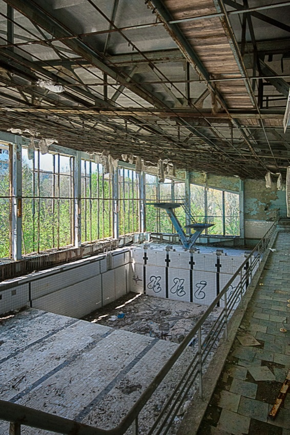 """Pripyat was built from the ground up as a Soviet """"model city,"""" and as such had attractions and amenities that many cities it's size just did not have.  This indoor recreation center was one such amenity.  Matt. Create."""