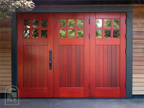 Bifolding, outswing garage doors! #unique #reddoors http://www.realcarriagedoors.com/gallery.php