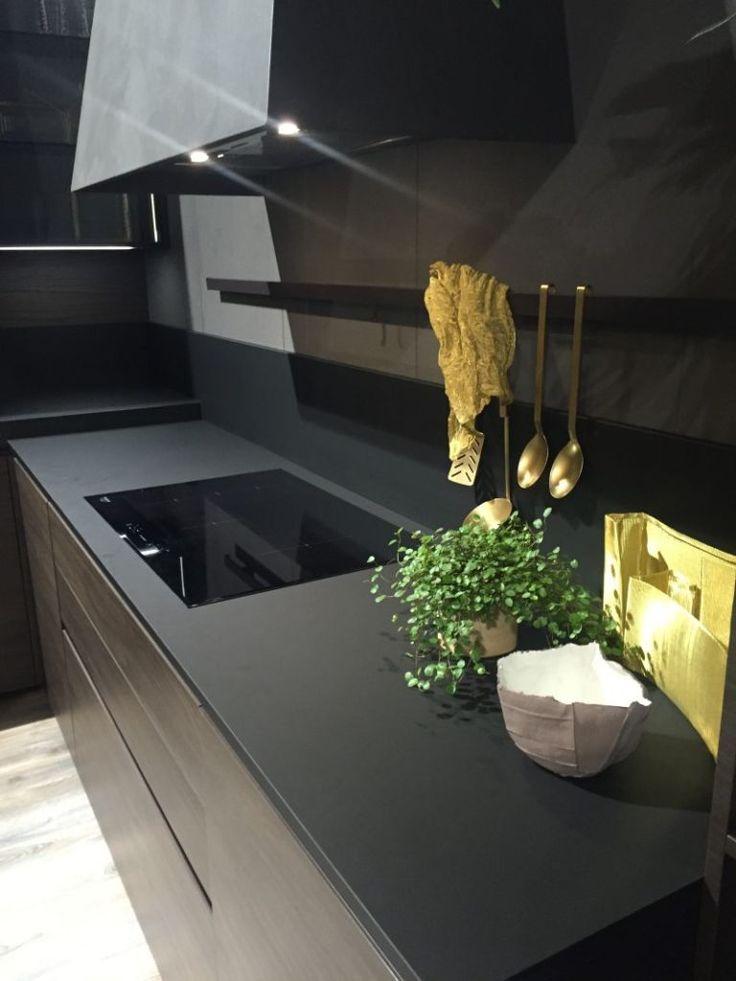 Black #kitchen design with #kitchen tools holder