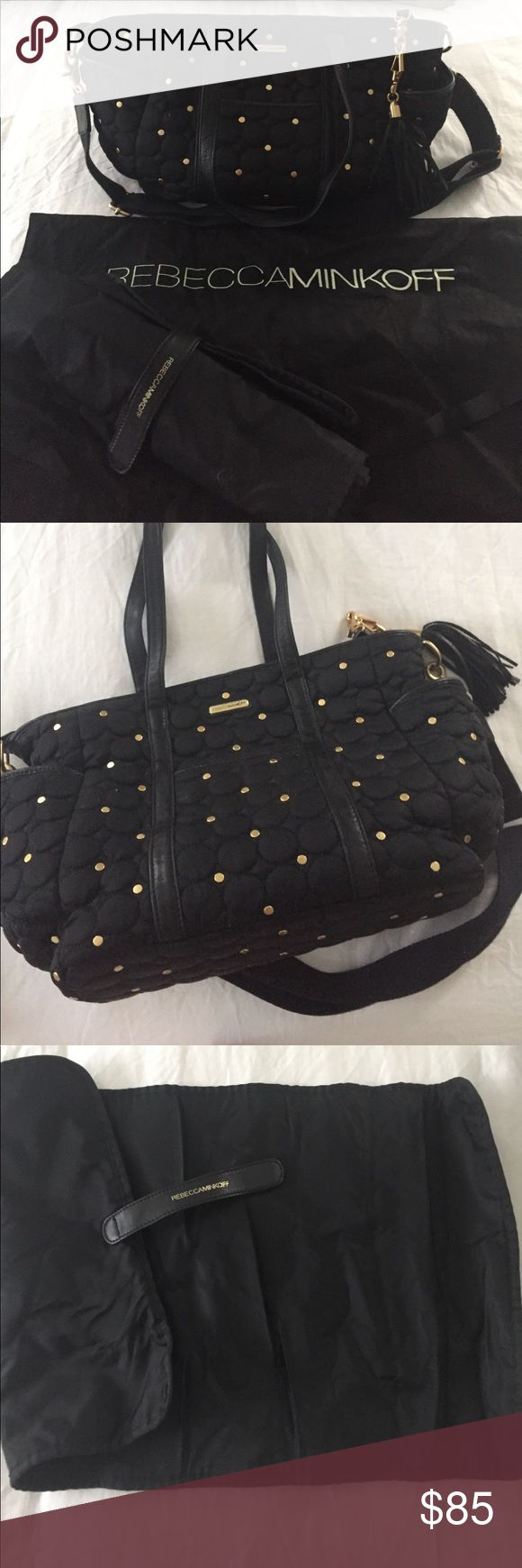 Diaper Bag Rebecca Minkoff In excellent used condition. Black quilted nylon with gold studs leather handles and tassel. Comfortable cross strap.comes with changing pad and dust bag. Adorable and amazing quality. Rebecca Minkoff Bags Baby Bags