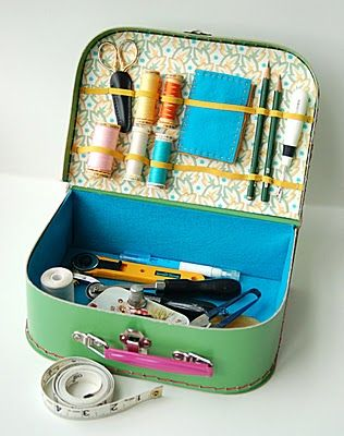 tutorial on making a sewing kit out of those lovely mini suitcases.  Those mini suitcases would be great in the vintage travel trailer.