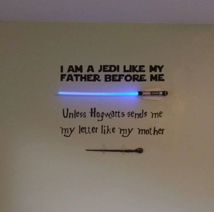 My wife decided to get our soon-to-be daughter on the right track early! She painted this in the baby room. And yes, that is a remote controlled light saber and a genuine wand from Harry Potter. -- Greg Daniels #Geek