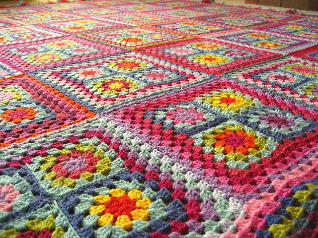 4 granny square sew together then crochet 4 rows around those 4 squares.  Then put together. Cute!!
