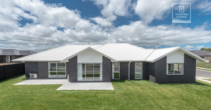 Good looking dark brick home combined with light colours on roof and joinery; by Yeoman Homes in Hamilton NZ
