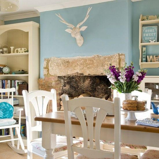 This homely decorating idea is perfect space for family gatherings. Soothing pastel shades contrast with the stronger tones used elsewhere in this country-style scheme.