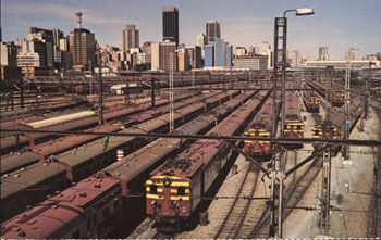 """Johannesburg as Kumalo enters the city.  """"Railway lines, railway lines, it is a wonder. To the left, to the right, so many that he cannot count.""""   -Kumalo's thoughts"""