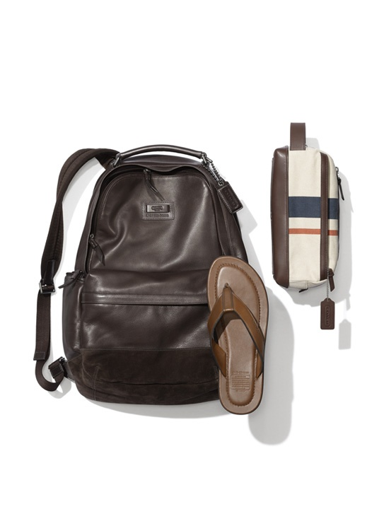 What to wear to Williamsburg: Coach Men's Rivington Leather Backpack, Peter Flip Flop and Bleecker Striped Canvas Travel Kit.    In our latest collaboration, Downtown From Behind takes Coach on two-wheel trips around NYC. Learn more on www.coach.com.