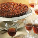 Caramelized Walnut Tart Recipe:  Several classic fortified wines, including tawny port and cream sherry, echo the aromas and tastes in this sweet, rich tart of caramel and nuts. A sweet Madeira works best to cast a lemony, refreshing complexity over the dessert. Dependable: sweet Madeira based on Bual or Malmsey. Daring: tawny port.