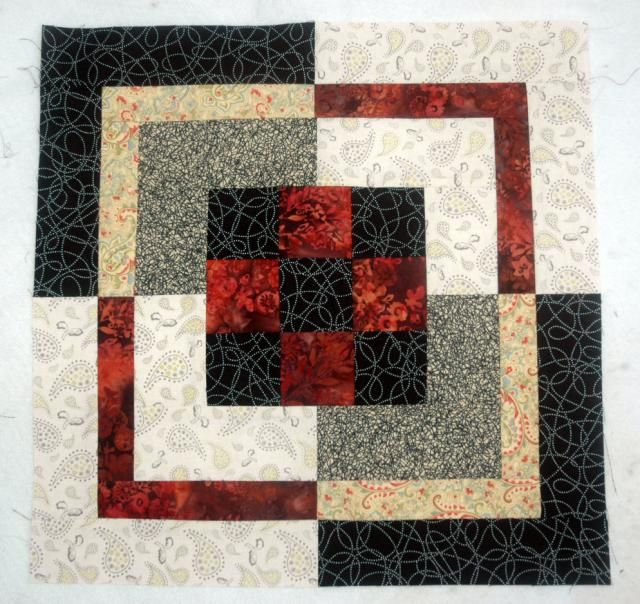 Use my step by step quilt pattern too sew a unique Nine Patch Bento Box quilt. By Janet Wickell at About.com Quilting.
