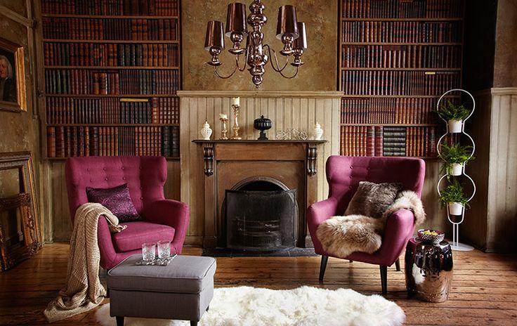 Lots of books, armchairs, rugs, blankies