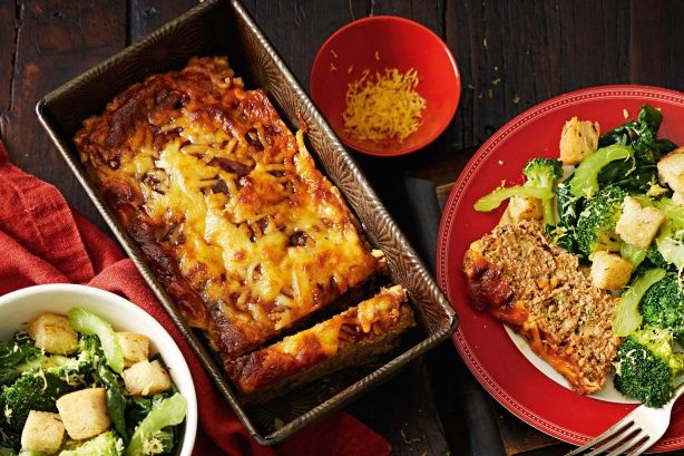 Cheesy meatloaf with warm greens salad - Create this family-friendly meal with leftovers to spare.