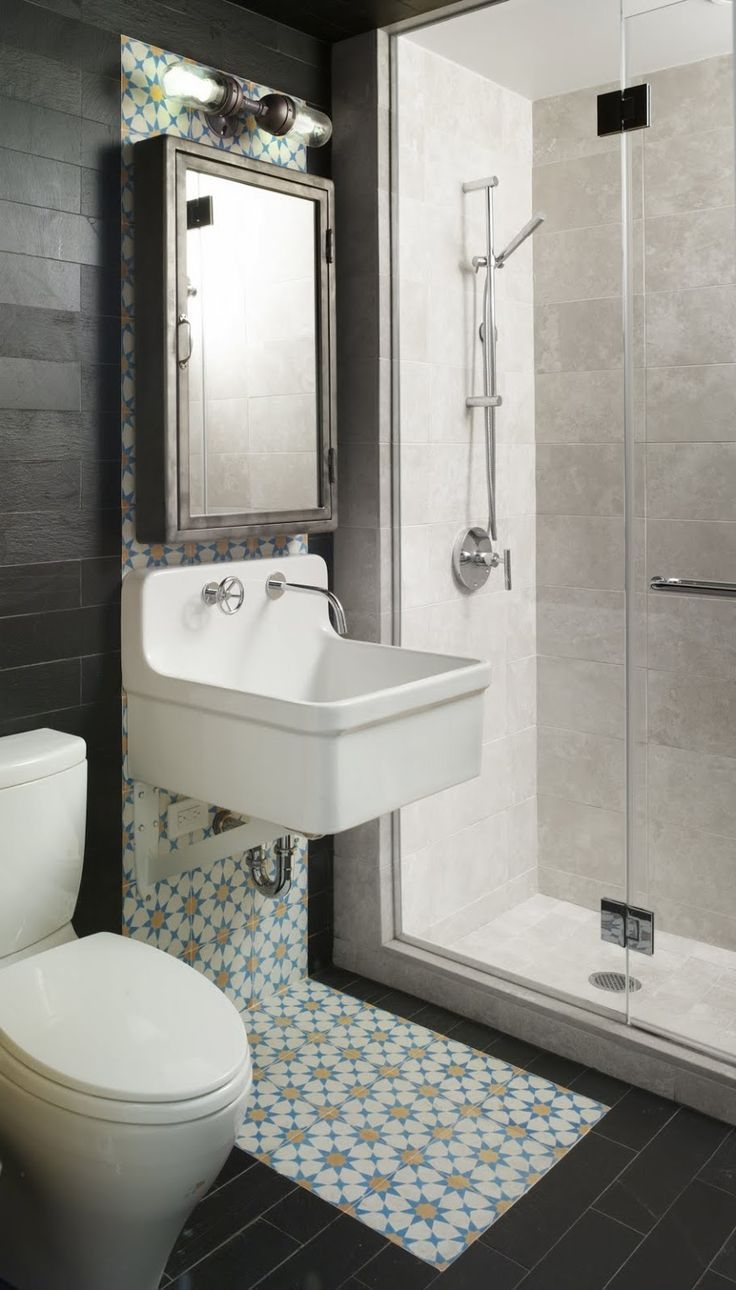 small bathroom with shower in the corner - Small Hotel Bathroom Design