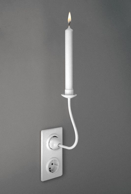 KERZENHALTDING is a candleholder, which simply uses the holding force of a power socket. The correlation between electricity and light is supposed to be irritated by that concept. The lit candle paradoxically emits light, although the plug does not transmit any electricity.