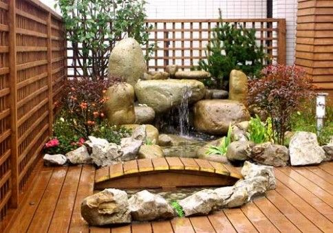 Idea for having rocks around the flower bed and around a little pond area -  small japanese garden   small japanese garden design ideas