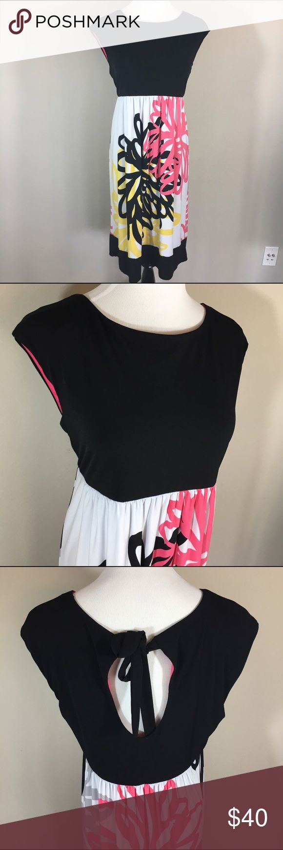 Black Friday Sale! Cap Sleeve Dress Cap sleeve dress with tie Keyhole detailing on the back. Has good stretch and hangs well. London Style Collection Dresses