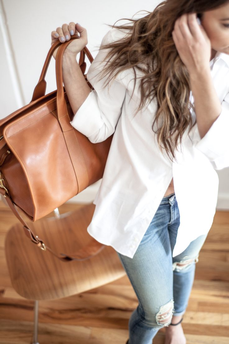 camel bag, linen shirt, and jeans...