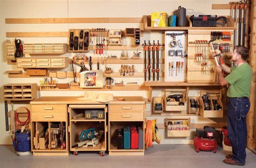 DIY Hook and Slat Wall System Puts Everything At Your Fingertips - wish I had the skills to make this. AWESOME