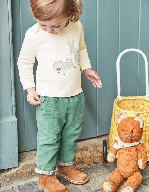 These cord trousers are soft and sweet, just like your baby. They're fully lined with soft jersey to keep wriggly little legs cosy and they're easy to pull on and off – so emergency nappy changes are a breeze. Simply turn up the hem to show off the print.