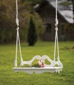 What a cute little swing!  This could be made from salvaged furniture parts + Decorating With Swings