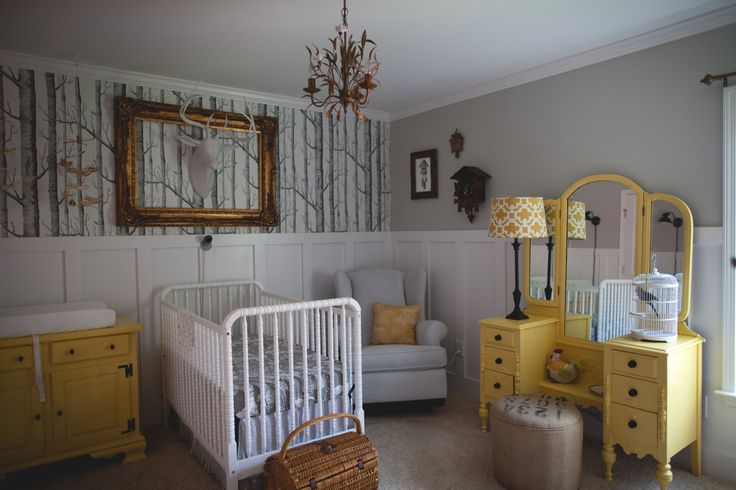 The woodland wallpaper, faux taxidermy deer and vintage furniture make this rustic nursery SO beautiful!