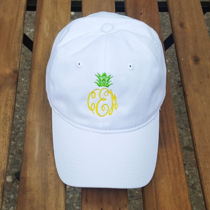 Can someone please pass the Pina Colada while we sip it in our Pineapple  monogram hat?This ladies monogrammed pineapple baseball cap is perfect for  the pool/beach,walking to class, or throw it on for your grocery store  run!  **Shown in white with canary and candy apple, option 2 font, we suggest  option 2 or option 10 font**  Please specify color hat, monogram font and thread color when ordering.  The order of the monogram is as follows:  first initial - last initial - middle initial…