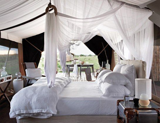 One of six suites at the Singita Mara River Tented Camp. Photo courtesy of Singita...love all white bedding