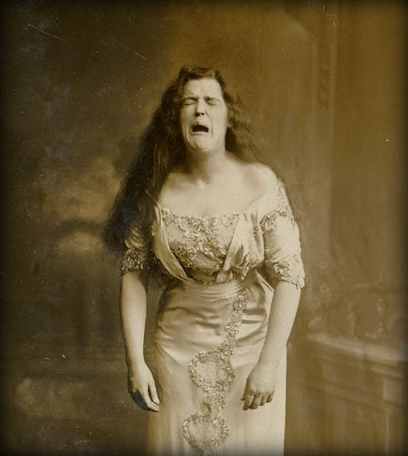 A portrait of a woman from around the turn of the century. This photo may have been taken mid-sneeze.