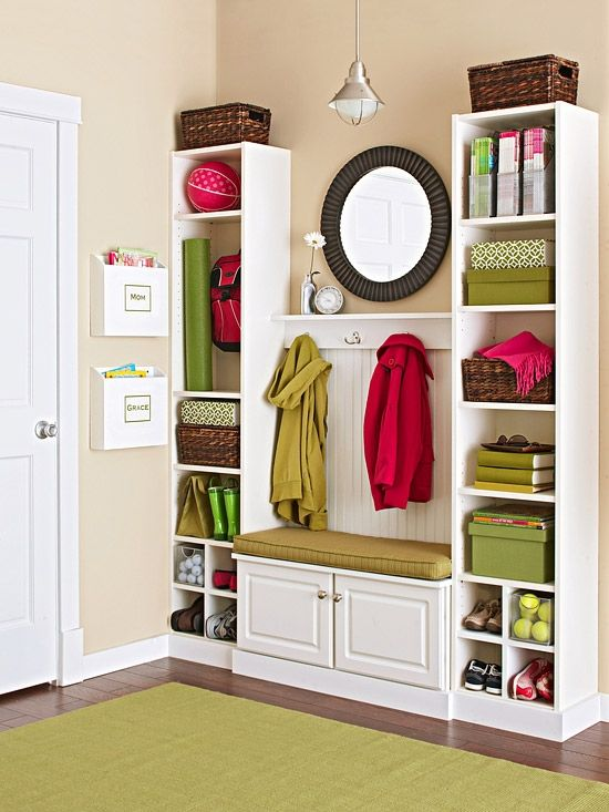 DIY Tutorial - Mini Mudroom using two tower bookcases, wall cabinet between them to serve as a bench, bead board and shelf with hooks above that.
