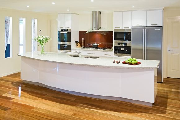 Steel appliances, splash-back contrasts nicely with the kitchen cupboards.