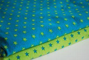Jersey étoiles anis fond turquoise - par 50 cm