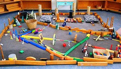 Working with blocks and construction materials covers many areas of the EYFS, including: personal, social emotional development (through imaginative and co-operative play), Art and design, Physical development and Understanding the world.