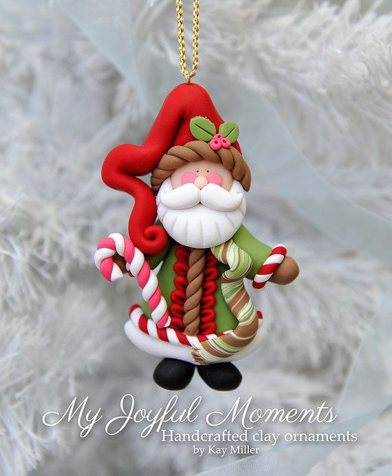 This is s one of a kind, handcrafted ornament made of durable polymer clay, with much attention given to detail and careful construction. No molds have been used, so you can be sure you are receiving a unique and one of a kind keepsake. This ornaments measures approximately 2 1/4 nches wide by 3 3/4 inches tall not including the ribbon hanger. The item in the photo is the exact item you are purchasing and will receive. This beautiful Santa Claus ornament made with lots of love and detai...