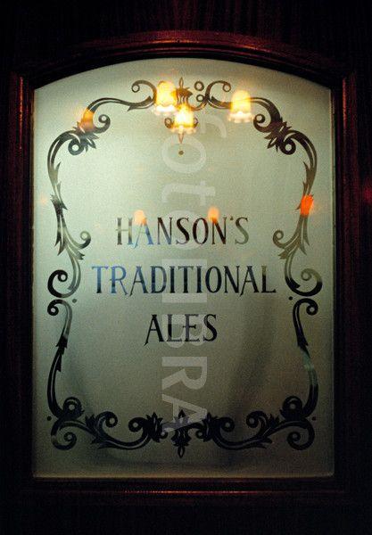 Etched glass door in pub, UK.