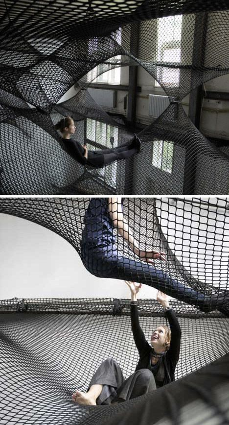 Net Installation consists of multiple layers of flexible nets suspended in the air, creating a floating landscape open for visitors to climb in and explore. By Numen.