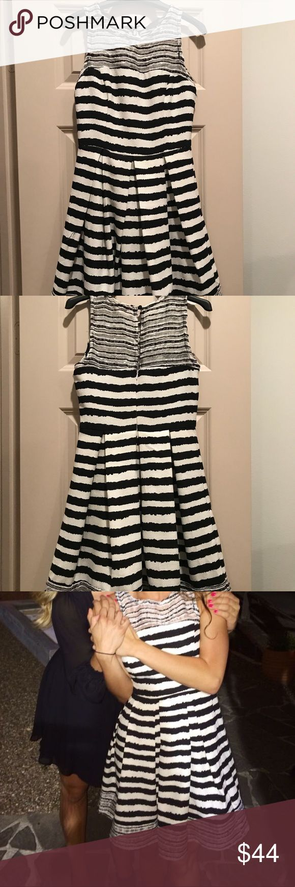 Black & White Striped Cocktail Dress This dress is fitted at the chest then flares out at the waist. The pattern makes such a fun statement! Only been worn once! Dresses Mini