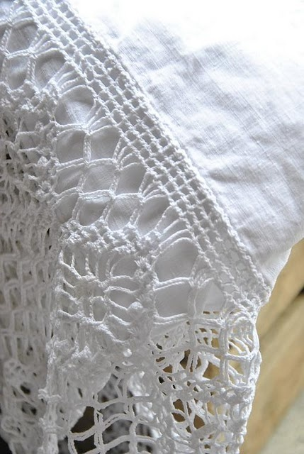 crochet edging on a linen pillowcase