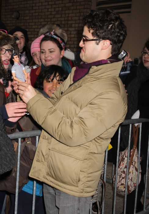 darren criss, at the stage door for H2$, holding a...blaine doll?