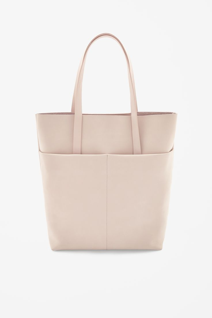 COS   Nubuck leather tote in beige   100% leather   Made from panels of soft nubuck leather, this unstructured tote bag is a relaxed unlined style. With two simple raw-cut leather straps, it has two lined outside pockets and a single pocket inside   30 x 38 x 10   £125