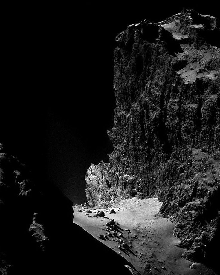 The kilometer-high cliffs of comet 67P/Churyumov–Gerasimenko, as seen by the Rosetta spacecraft.