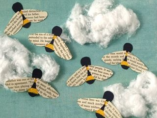 Bumblebees wings from old book pages.  Would be pretty on a swirly blue canvas.