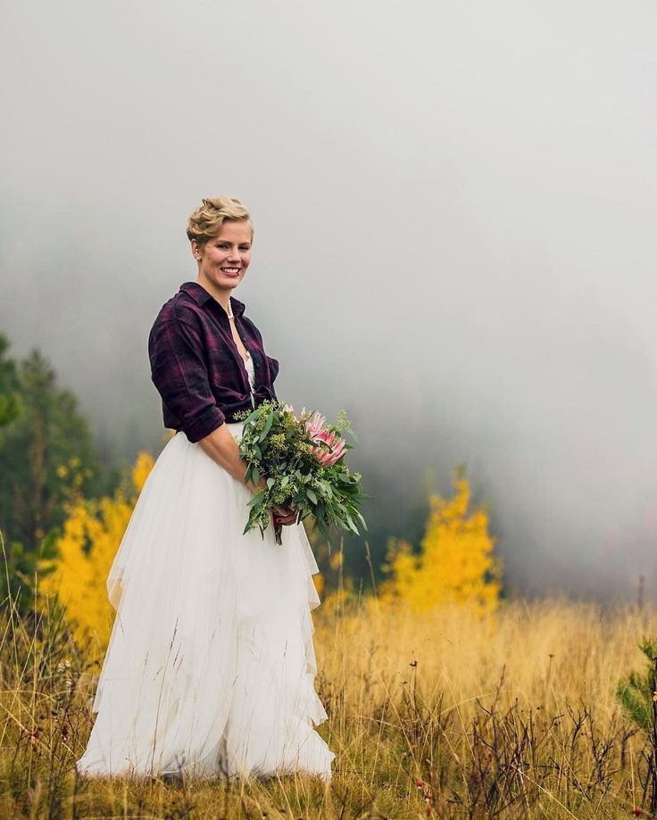 Laughing and giggling the entire day despite the little bit of torrential downpour.  #fernieweddings #mountainwedding #ferniephotographer