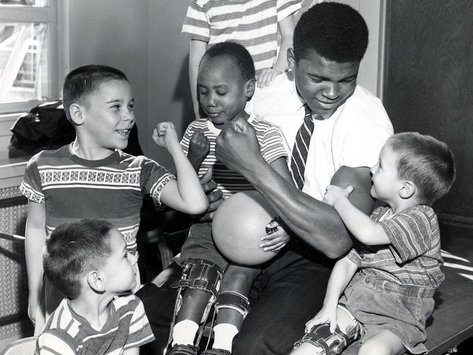 Home from the 1960 Olympics, where he was a gold medalist in boxing. Muhammad Ali paid visit to physically challenged children at Kosair Hospital in Louisville, Ky. Photo by Al Hixenbaugh  Oct 20, 1960 (Via MerlinFTP Drop) Al Hixenbaught, The Courier - Journal