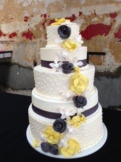 grey, white, yellow wedding cake with gum paste flowers.