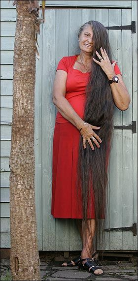 70 Years Old Woman Who Has Long Hair Down To The Ground