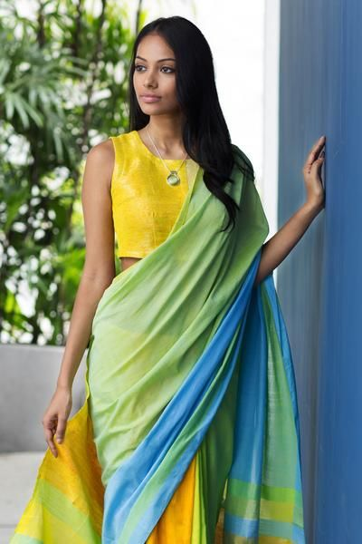 Bright and light as tropical day time, this sari glows with yellows yet stays fresh and cool with colours of sky and greens.
