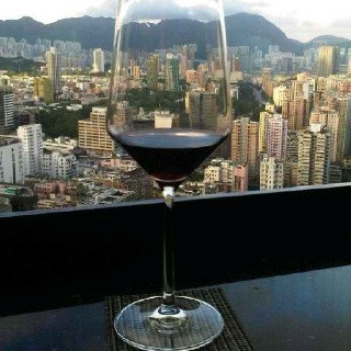 Hong Kong - Sipping wine with a view of Hong Kong from the Langham Place Hotel. Photo by KG.