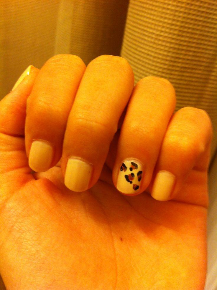 Cheetah leopard nail design.